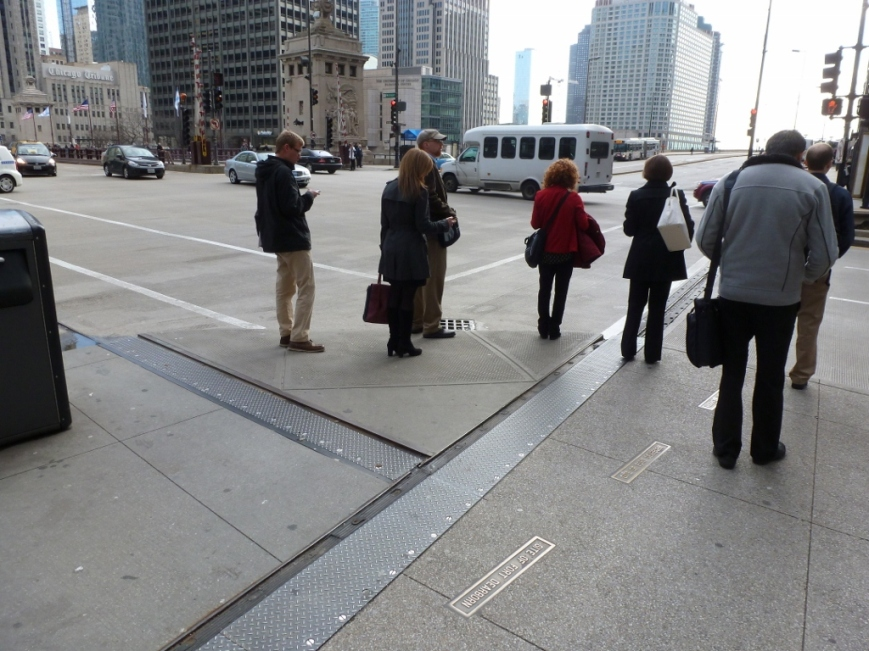 Metal Joints across road and sidewalk on Michigan Ave